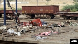 A destroyed tea stall is seen at the scene following an overnight bomb explosion at the Sibi railway station in southwestern province of Balochistan late on June 27.