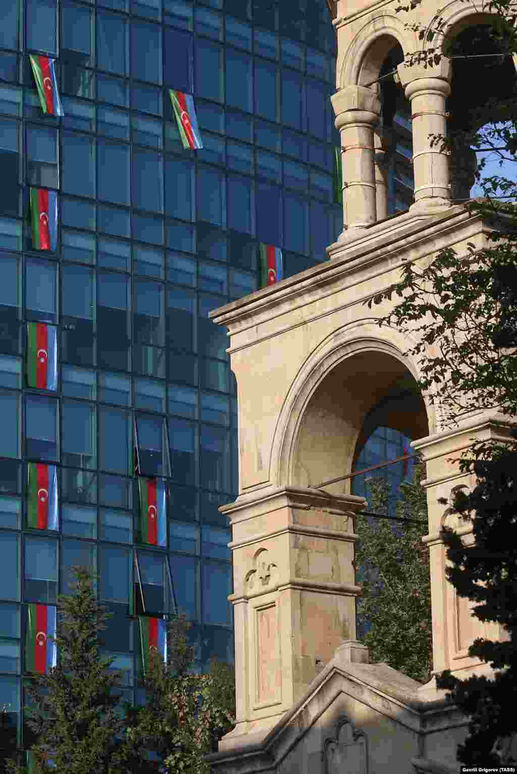 St. Gregory the Illuminator Church (right) and the offices of the International Bank of Azerbaijan are adorned with national flags on November 4.