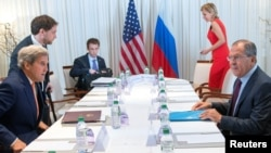 U.S. Secretary of State John Kerry (front left) and Russian Foreign Minister Sergei Lavrov (front right) sit down for bilateral talks focused on the Syrian crisis in Geneva on August 26.