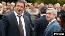 Armenia - President Serzh Sarkisian (R) and businessman Gagik Tsarukian attend the consecration of a new church built by the latter in Abovian, 14May2013.