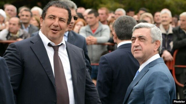 Armenian President Serzh Sarkisian (right) and businessman Gagik Tsarukian,  head of the Bargavach Hayastan (Prosperous Armenia) party, attend the consecration of a new church built by Tsarukian in Abovian on May 14.