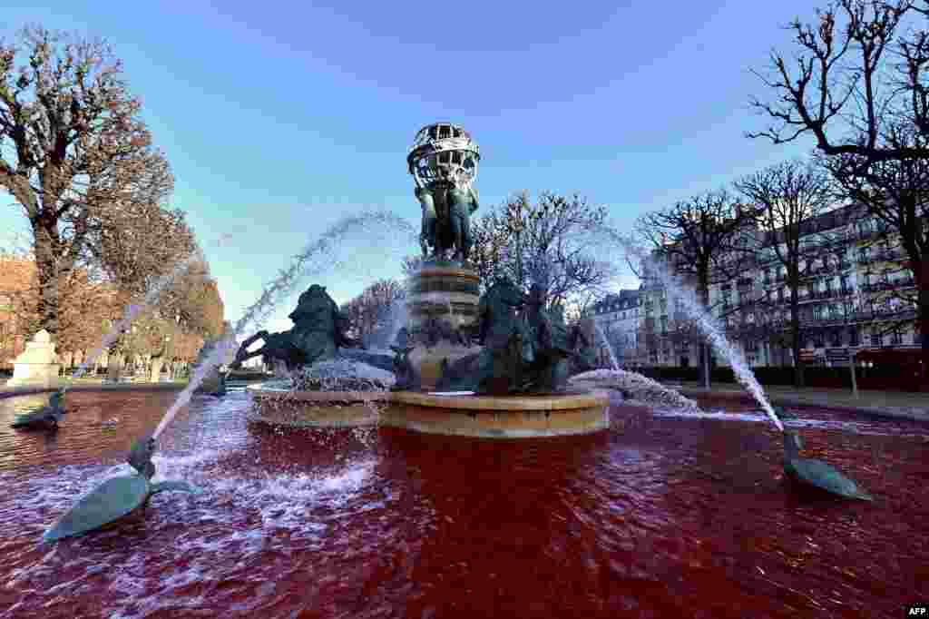 Red water looking like blood flows at the Nouvel Observatoire fountain in Paris after health-care professionals affiliated with the Le Bloc union poured red dye in many of the city's fountains to protest against the implementation of a new cooperative network scheme that they say would undermine the freedom to choose one's own doctor. (AFP/Miguel Medina)