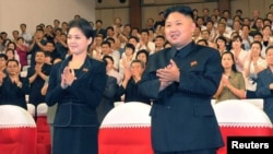 North Korean leader Kim Jong-Un (right) has been appearing in public with a mystery woman (left) in recent weeks.