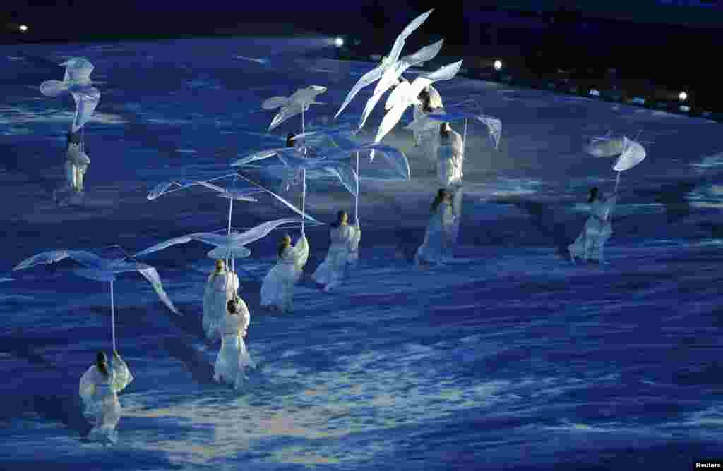 Performers take part in the show during the closing ceremony. (Reuters/Issei Kato)