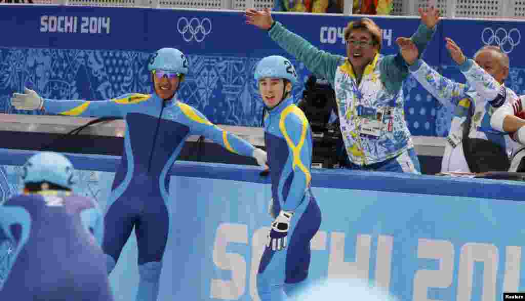 Kazakh skaters Denis Nikisha and Nurbergen Zhumagaziev (left) after the men's 5,000 meters short track speed skating relay semi-final in the Iceberg Skating Palace.