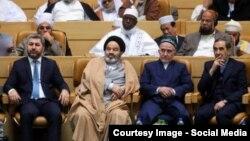 Muhiddin Kabiri (left) pictured with other conference delegates in Tehran on December 28.