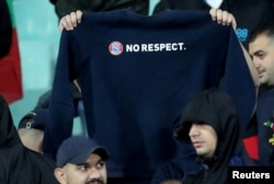 "A Bulgaria fan holds up a ""No respect"" shirt during the game on October 14."
