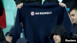 "Bulgarian fans at the game deride UEFA's ""Respect"" campaign aimed at curbing racism in soccer."