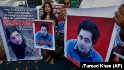 Members of a Pakistani civil-society group demonstrate against the killing of university student Mohammad Mashal Khan last year.