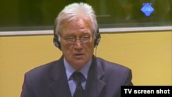 Momcilo Perisic, the former chief of staff of the Yugoslav People's Army, appears in court in The Hague in October.