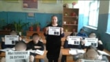 A teacher and her students show their support for President Vladimir Putin.