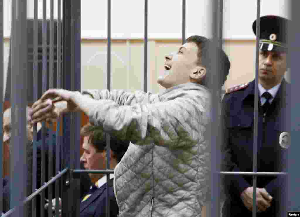Jailed Ukrainian military pilot Nadezhda Savchenko reacts inside a defendants' cage as she attends a court hearing in Moscow on May 6. (Reuters/Sergei Karpukhin)