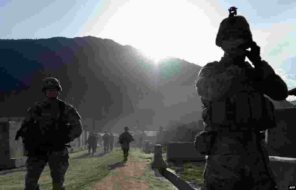 U.S. Army soldiers march from the Forward Base Honaker Miracle in Kunar Province, Afghanistan, during a joint patrol led by the Afghan National Army on April 18. (AFP/Manjunath Kiran)