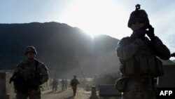 FILE: U.S. army soldiers patrol alongside Afghan National Army soldiers in the eastern Kunar province.