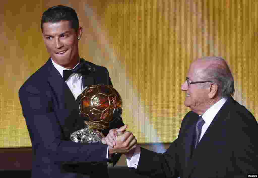 Real Madrid's Cristiano Ronaldo of Portugal is congratulated by FIFA President Sepp Blatter after winning the FIFA Ballon d'Or 2014 as the year's best player during an awards ceremony at the Kongresshaus in Zurich, Switzerland. (Reuters/Arnd Wiegmann)