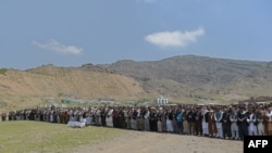 Afghan mourners offer funeral prayers for a victim killed in a Taliban truck-bomb attack in April. New figures indicating that rates of civilian casualties in the restive country may be leveling off at near-record levels after steadily increasing over the previous years.