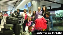 Armenia -- A Syrian Armenian family from Aleppo arrives at Yerevan airport, 25Oct2016.
