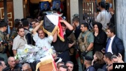 Iraqi Christians carry coffins during a funeral service at a church in Baghdad last year.