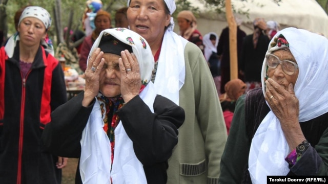 Torokul Doorov's winning photograph shows women offering their blessings at a circumcision celebration in Batken Region, Kyrgyzstan.