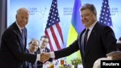 The White House announced more aid for Ukraine after U.S. Vice President Joe Biden met with Ukraine's President Petro Poroshenko.