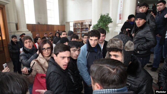Armenia - Pro-government youths prevent journalists from covering the supposedly public defense of Yerevan Mayor Taron Markarian's doctoral thesis, Yerevan, 26Dec2013.