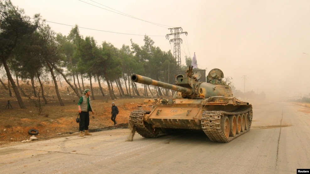A tank of the rebels drives in Dahiyat al-Assad, the western part of Aleppo, on October 28.