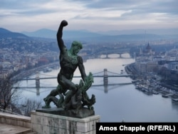 A dragon-pummeling bronze figure makes up part of Budapest's Liberty Monument.