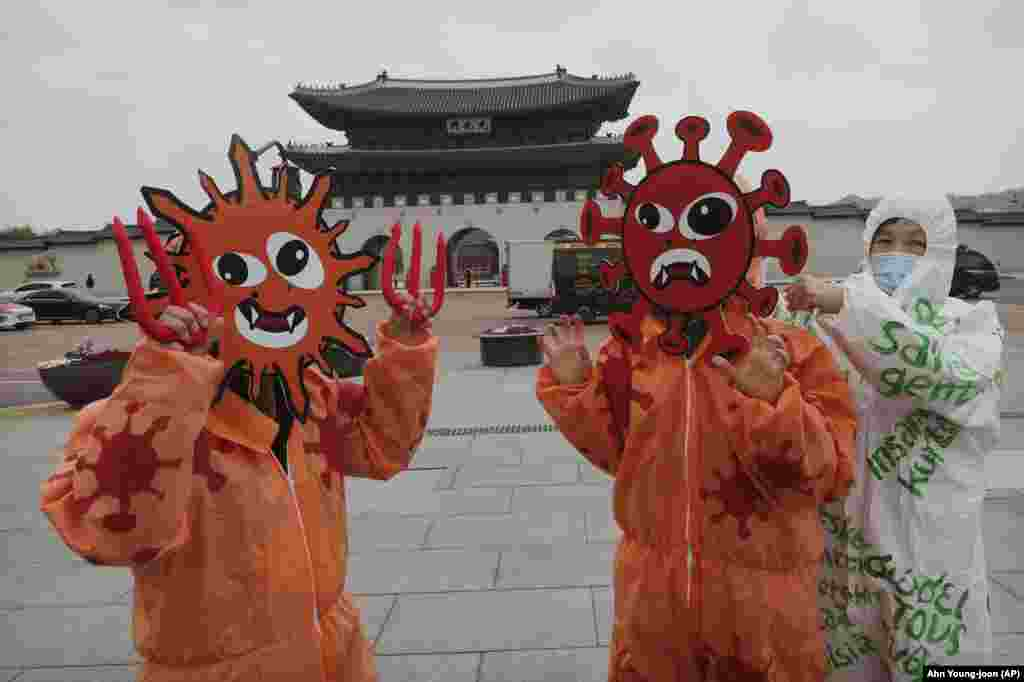 Members of the Environmental Health Citizens' Association of Korea wearing masks representing the viruses perform during an event to celebrate the 50th anniversary of Earth Day at Gwanghwamun Square in Seoul, South Korea, Wednesday, April 2​2, 2020. ​Each year Earth Day addresses different global climate, health and environmental issues. Two crises are addressed during 2020 Earth Day events: COVID-19 coronavirus pandemic and a slow building of a disaster for the planet's climate.