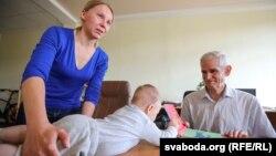 Тацяна Віткоўская, маленькі Марк і Джон Лін Росман