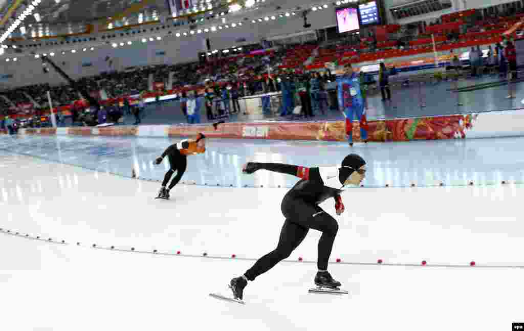 Silver-medal-winner Denny Morrison of Canada (front) in action during the men's 1,000-meter speed-skating race
