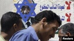 Звезда Давида нарисована на плакате с портретом кандидата в президенты Омара Сулеймана - бывшего при Хосни Мубараке вице-президентом и шефом разведки