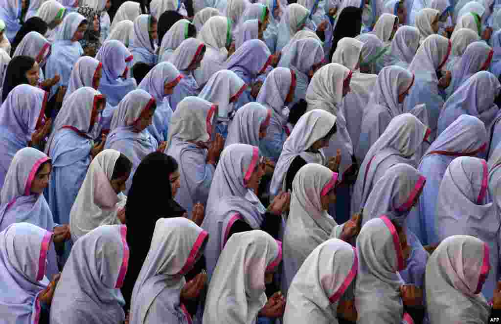 Pakistani schoolgirls offer prayers for Nobel Peace Prize laureate Malala Yousafzai during a school assembly in Mingora in the Swat Valley. (AFP/A. Majeed)
