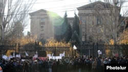 Armenia - Hundreds of people demonstrate against a controversial pension reform outside the parliament building, Yerevan,04Dec2013