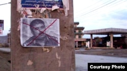 A defaced poster of former Afghan warlord Abdul Rashid Dostum posted in Kabul last year.