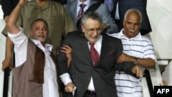 Convicted Lockerbie bomber Abdelbasset Ali al-Megrahi (center) was welcomed as a hero on his return to Tripoli after release by Scottish authorities on compassionate grounds in August 2009.