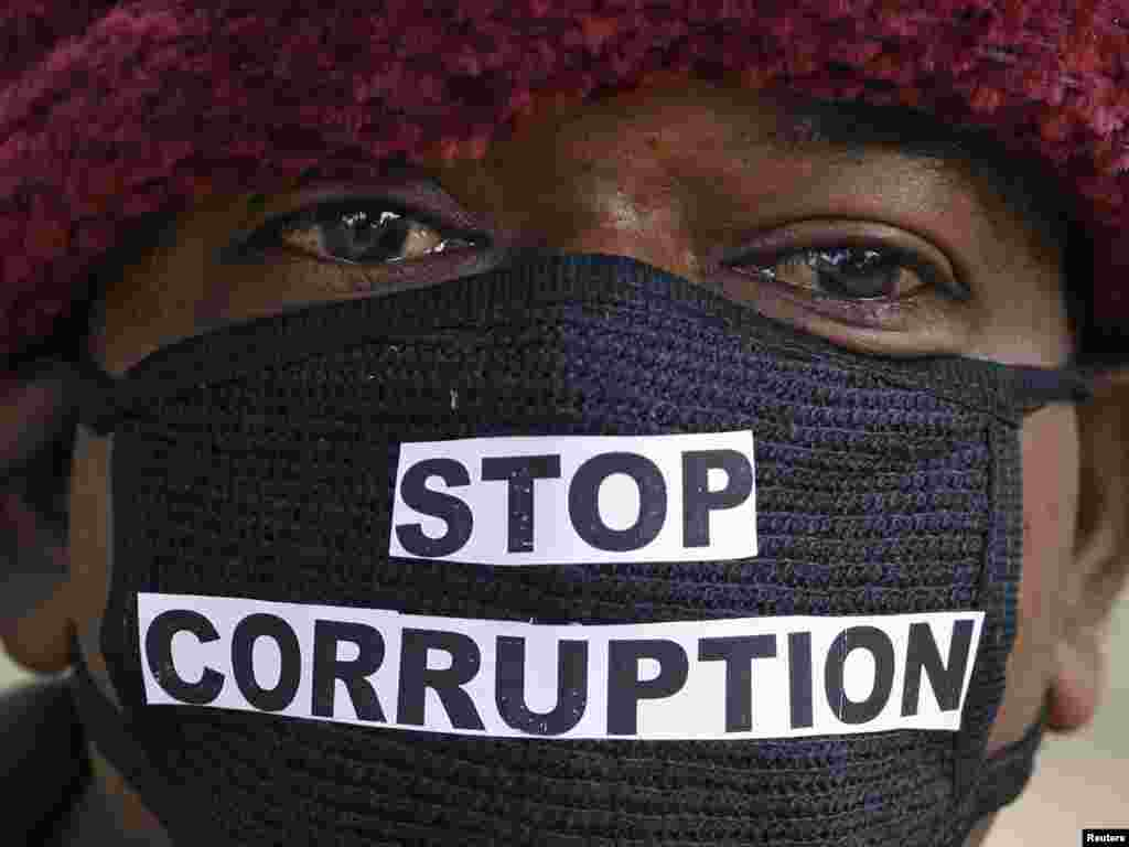 An Indian telecom employee takes part in a silent protest against a corruption scandal on December 9. Photo by Parivartan Sharma for Reuters