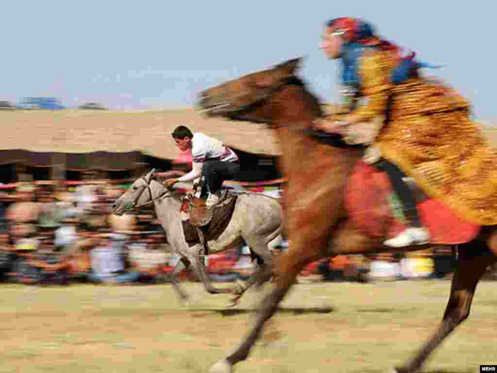 Nomads race on horseback during a cultural festival in Semirom, southern Iran. Photo by Mehr