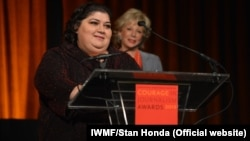 """Khadija Ismayilova accepting the 2012 """"Courage in Journalism"""" award from the International Women's Media Foundation in New York in October."""