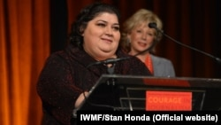 Khadija Ismayilova accepts the 2012 Courage in Journalism award from the International Women's Media Foundation in New York in October 2012.