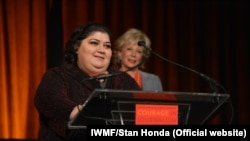 "RFE/RL Azerbaijani Service correspondent Khadija Ismayilova accepting the 2012 ""Courage in Journalism"" award from the International Women's Media Foundation in New York. October 24, 2012."