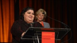 "RFE/RL Azerbaijani service correspondent Khadija Ismayilova accepting the 2012 ""Courage in Journalism"" award from the International Women's Media Foundation. Behind Ismayilova is Lesley Stahl, CBS News journalist and presenter of the award. The ceremony took place in New York on October 24, 2012. Photo: IWMF/Stan Honda"