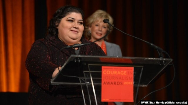 RFE/RL's Azerbaijani Service correspondent Khadija Ismayilova accepts the 2012 'Courage in Journalism' award from the International Women's Media Foundation in New York in October 2012.