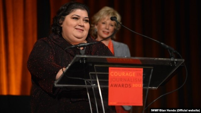 "Khadija Ismayilova accepting the 2012 ""Courage in Journalism"" award from the International Women's Media Foundation in New York in October."