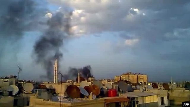 Smoke billows from the Damascus suburb of Douma during shelling by government forces on April 15.