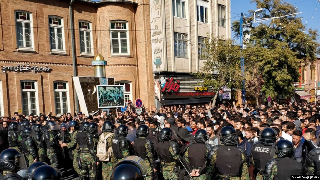 Riot police confront protesters in the city of Urmia on November 16. One Iranian lawmaker has said more than 7,000 people were arrested during the protests.
