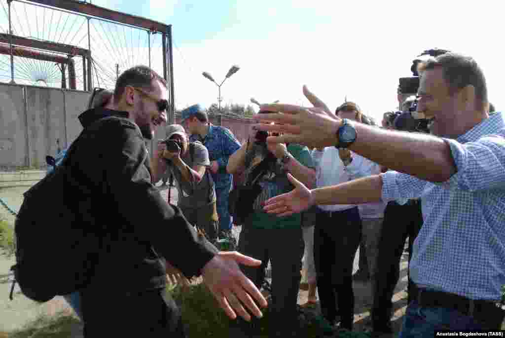 Russian opposition leader Aleksei Navalny (right) greets his brother Oleg Navalny (left) after he was released after spending 3 1/2 years in prison in the western Oryol region on June 29. In 2014, the two brothers were convicted of stealing about $500,000 from two Russian firms and of laundering some of the money. Both were sentenced to 3 1/2 years, but Aleksei's sentence was suspended. The European Court of Human Rights has ruled that the brothers were convicted unfairly. (TASS)