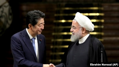 Japanese Prime Minister Shinzo Abe, left, and Iranian President Hassan Rouhani shake hands after their joint press conference at the Saadabad Palace in Tehran, Iran, Wednesday, June 12, 2019. The Japanese leader is in Tehran on an mission to calm tensions between the U.S. and Ira