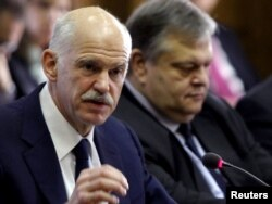 Greek Prime Minister George Papandreou (left) and Finance Minister Evangelos Venizelos in an urgent cabinet meeting in Athens on November 3.