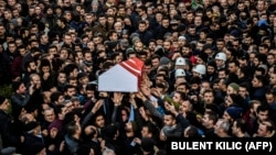 People carry the coffin of Yunus Gormek, 23, one of the victims of the Reina nightclub attack, during his funeral in Istanbul on January 2.