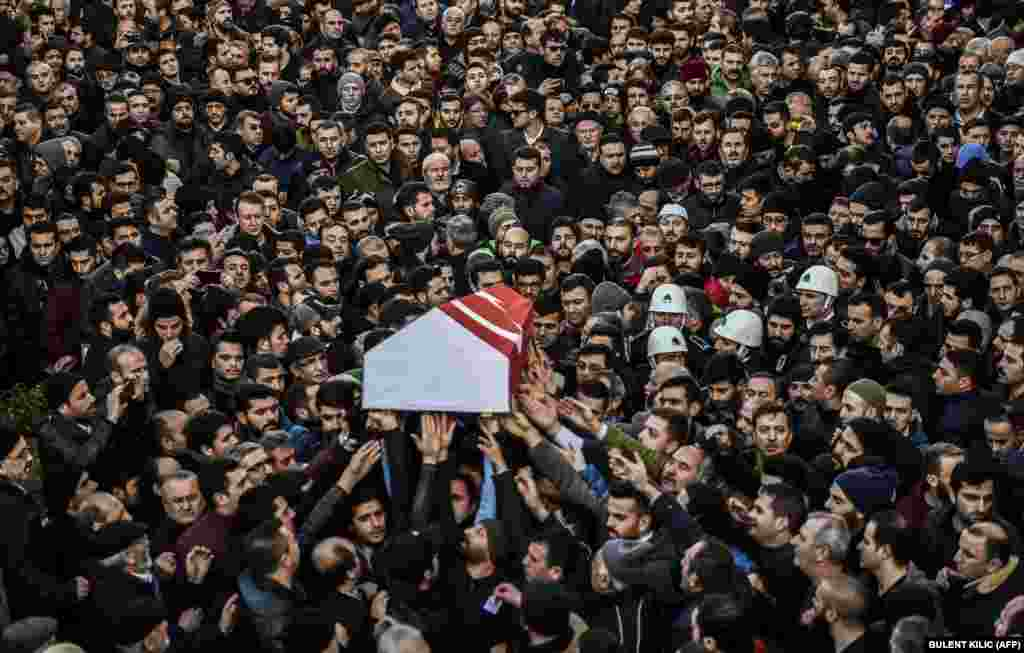 People carry the coffin of Yunus Gormek, 23, one of the victims of the Reina nightclub attack, during his funeral ceremony in Istanbul on January 2. (AFP/Bulent Kilic)